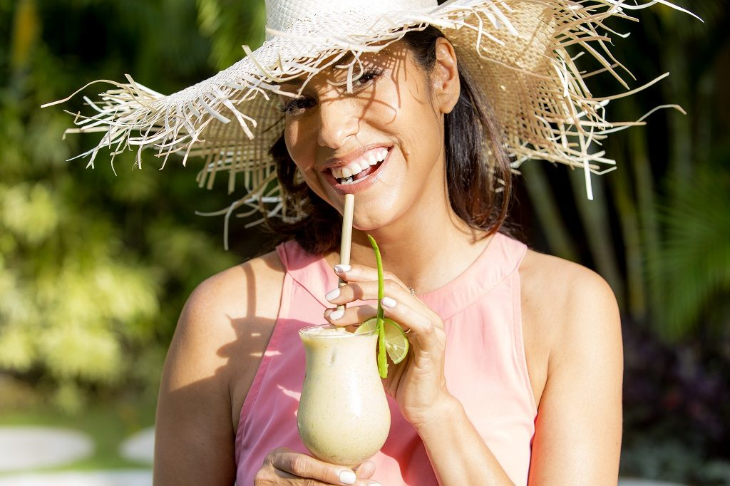 Classic straw hat pared with a Kubu Aloe juice